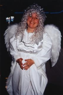 me wearing angel costume at work